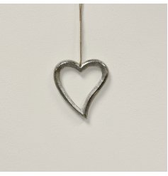 A luxe silver hanging heart decoration made from metal. Complete with a jute string hanger.