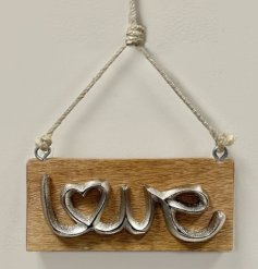 A charmingly rustic inspired hanging wooden plaque featuring a distressed metal scripted text decal
