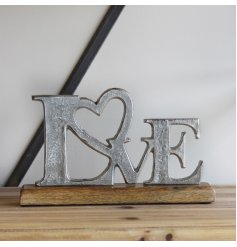 A natural wood block based ornament featuring a rough finished LOVE decal