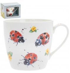 A delightful little Fine China Mug displayed with a charming watercolour inspired ladybird print