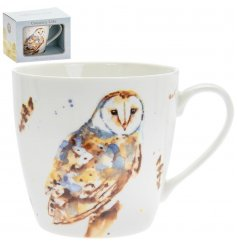 A delightful little Fine China Mug displayed with a charming watercolour inspired owl print