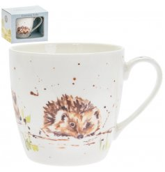 A delightful little Fine China Mug displayed with a charming watercolour inspired hedgehog print