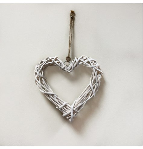 A small natural rattan hanging heart, perfect for adding additional twinkling lights or foliage. With jute for hanging.
