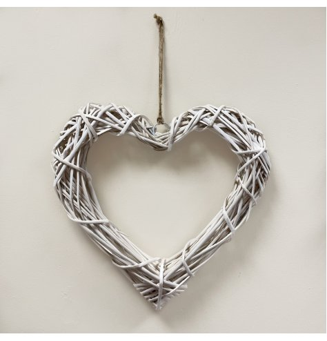 A medium natural rattan hanging heart, perfect for adding additional twinkling lights or foliage. With jute for hanging.