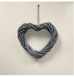 A grey toned woven wicker heart wreath, sure to bring a stylish hint to any home throughout all the seasons