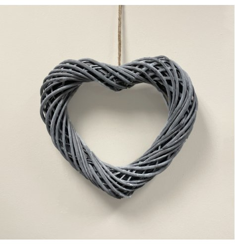 An large sized woven wicker heart hung from jute string, make your own by adding lights and foliage