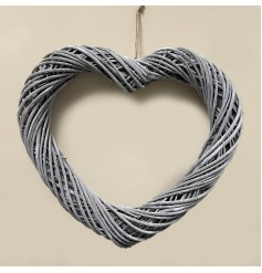 A large sized woven wicker heart shaped wreath set with a stylish soft grey tone and jute string for hanging