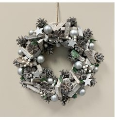 A large decorative wooden wreath with added bold silver tones and festive accents