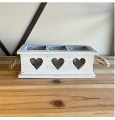 A rustic wooden tray set with heart cut decals, chunky rope handles and spaces for candles