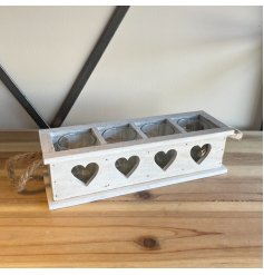 A white painted wooden candle holder tray set with a 4 space inner for candles