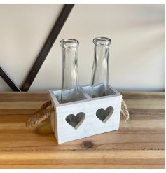 A white wooden tray decorated with heart cut decals and chunky rope handles