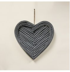 A gorgeous hanging heart decoration made up of natural twigs in a pretty pattern