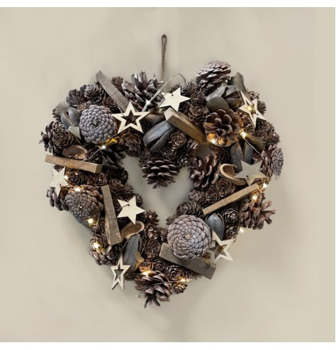 A beautifully rustic wreath with wooden stars, pinecones and added foliages to set the look. Dazzled with added warm whi