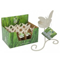 A charmingly simple candle holder featuring a sweet butterfly decal