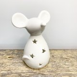 A charmingly simple ceramic mouse decoration with a sleek white glaze and cut star decal