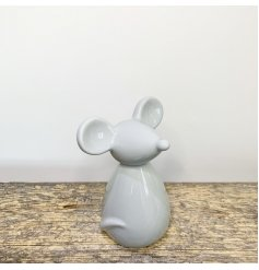 A simple and plain grey toned ceramic mouse with large ears and cute note