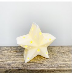 A chic and simple ceramic star decoration complete with a warm glowing LED centre and small star cut features