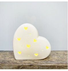A chic and simple ceramic heart decoration complete with a warm glowing LED centre and small heart cut features