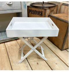 A stylishly simple white wooden table tray featuring a distressed and trendy look