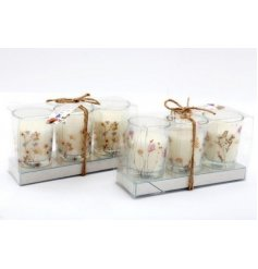 Perfect for bringing a Spring feel to your home, a mix of scented candle pots in charming display boxes