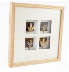 A large natural wooden framed plaque featuring a selection of dried grasses