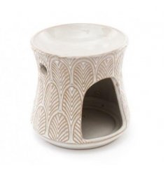 A sleek and simple decorative oil burner featuring a leaf embossment and off white colouring to finish