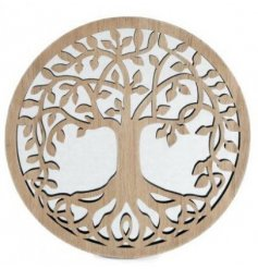 A large round mirror featuring a Tree of Life cut decal over it