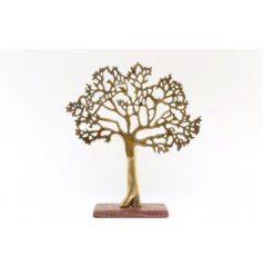 A stylish tree decoration with an antique golden finish, set upon a chunky wooden base
