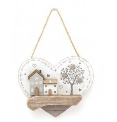 A distressed white toned wooden heart plaque, set with a house scene and tree to feature on the front
