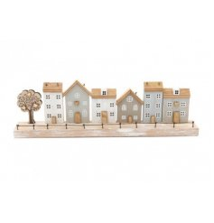 A distressed wooden plaque, set with a house scene and tree to feature on the front