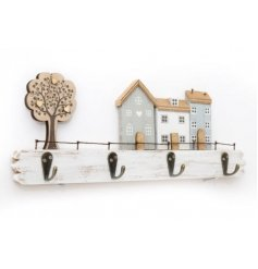 A distressed wooden plaque, set with a house scene and tree to feature on the front and added hooks