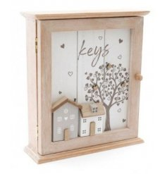 A distressed white toned wooden key box, set with a house scene and tree to feature on the front