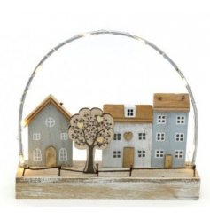 A distressed wooden house and tree scene, set with added warm glowing LED lights