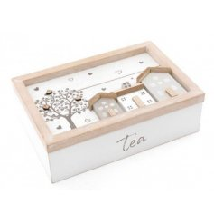 An overly distressed white wooden tea compartment box, complete with a sweet house scene and tree decal to the front