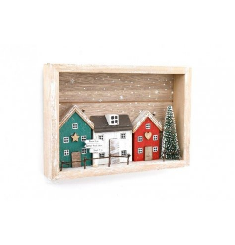 A wooden based village scene set with nordic tones and festive decals around it