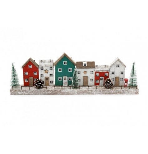 A wooden based village scene plaque set with nordic tones and festive decals around it