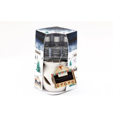 A set of scented essential oils and a ceramic burner, complete with a festive Christmas Market printed packaging