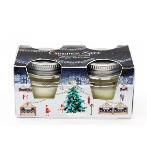 A set of small scented candles within a charming Christmas Town inspired packaging