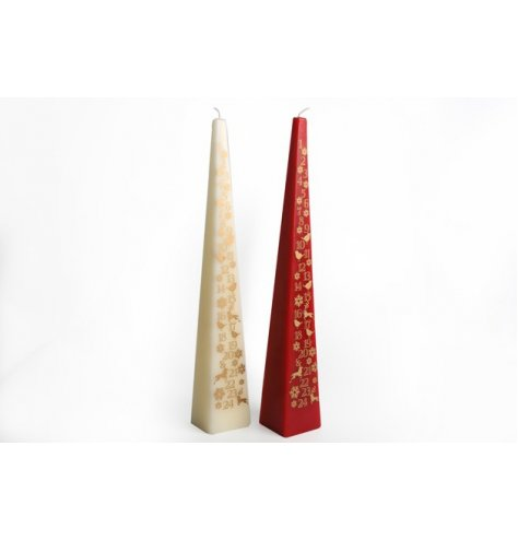 An assortment of pyramid shaped advent candles in cream and red tones