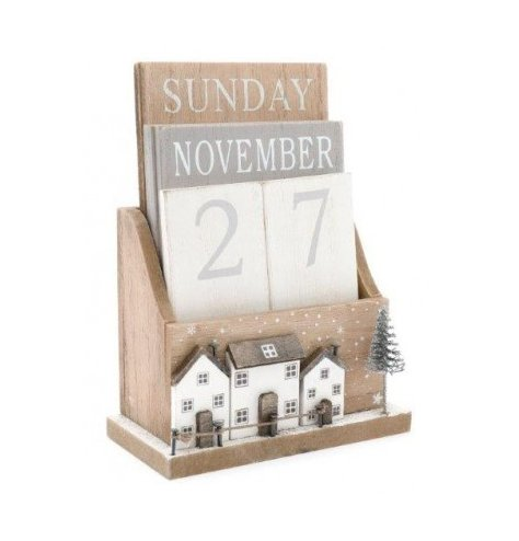 A wooden based count down calendar with a Winter Village inspired decal around it