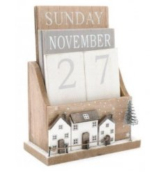 A festive themed count down calendar, set with Scandi inspired colour tones and festive prints
