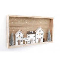 a rustic wooden frame plaque with a wintered village display