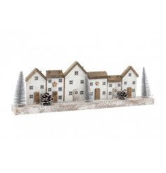 A festive themed wooden village display, set with Scandi inspired colour tones and festive decals
