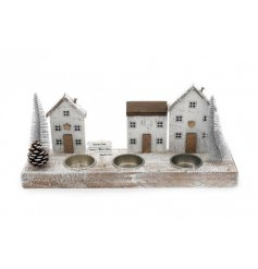 A festive themed wooden village tlight holder display, set with Scandi inspired colour tones and festive decals
