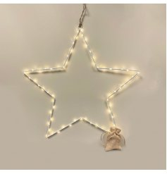 A sleek and simple extra large white wire star entwined with warm glowing LED Lights