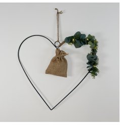 A stunningly simple black wire heart entwined with warm glowing LED Lights and a foliage finish