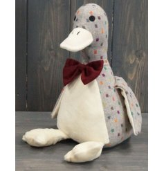 A delightful little sitting duck doorstop made from a grey and multi toned spotted fabric