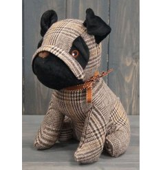 Set with a beige and natural toned tartan print fabric, this doggy doorstop also features a sweet orange ribbon bow