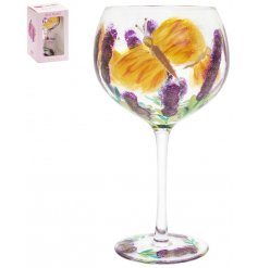 A gorgeously hand painted gin glas with a butterfly inspired design