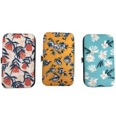 A charming mix of manicure sets, each with a variation of botanical prints